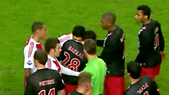 Luis Suárez bites Otman Bakka when playing for Ajax in 2011